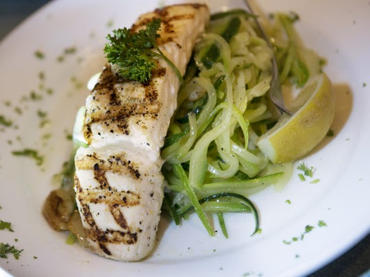 Halibut with zucchini noodles at Seafood Gourmet on Thursday June 15, 2017. Food Editor for The Record and NorthJersey.com Esther Davidowitz and Ben Pollinger who spent ten years as the Executive Chef at Oceana in New York City take a fishy food crawl through Bergen County.