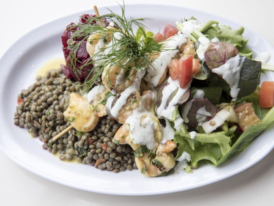 Shrimp kebabs with lentils, greens and beet salad at