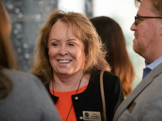 Pam Chandler enjoys the company of friends as The Heritage Foundation celebrates it's 50th anniversary with a special event at the Franklin Theater in Franklin, Tenn. on Nov. 12, 2017.