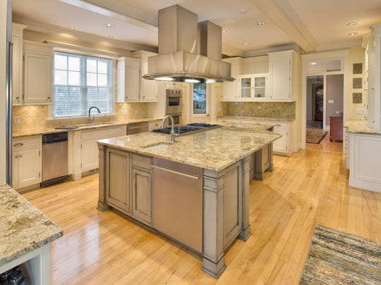 The kitchen features granite countertops, two dishwashers, two garbage disposals and handcrafted cabinets.