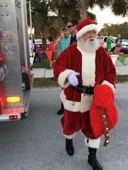 Santa arrives for the Jingle Bell 2-miler.