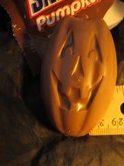 A football-shaped Snickers Halloween pumpkin.