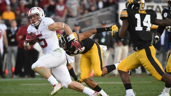 Jan 1, 2016; Pasadena, CA, USA; Stanford Cardinal running back Christian McCaffrey (5) runs against Iowa Hawkeyes defensive back Greg Mabin (13) during the third quarter in the 2016 Rose Bowl at Rose Bowl. Mandatory Credit: Robert Hanashiro-USA TODAY Sports