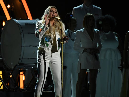 Kesha performs 'Praying'  during the 60th Annual Grammy