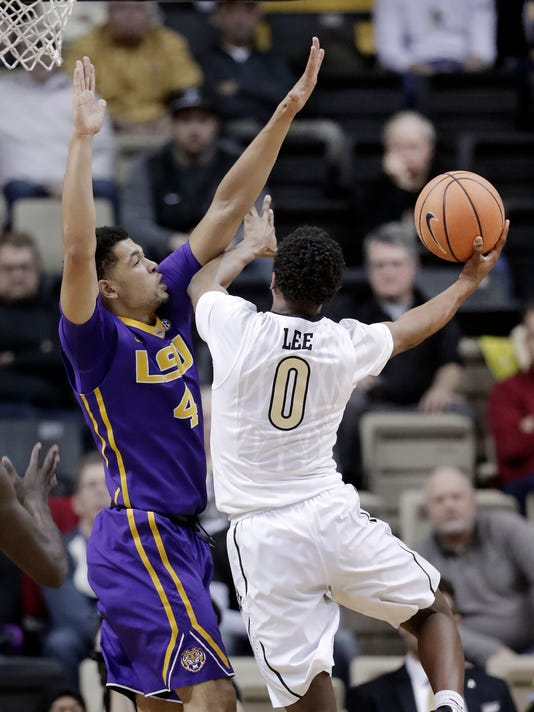 Vanderbilt guard Saben Lee (0) shoots against LSU guard Skylar Mays (4) in the second half of an NCAA college basketball game Saturday, Jan. 20, 2018, in Nashville, Tenn. Vanderbilt won 77-71. (AP Photo/Mark Humphrey)