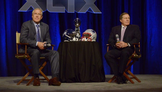 Seattle Seahawks head coach Pete Carroll, left, and New England Patriots head coach Bill Belichick during a joint press conference for Super Bowl XLIX at Phoenix Convention Center.