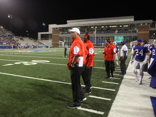 Louisiana Tech coach Skip Holtz, center, helped get his assistants raises for 2015.