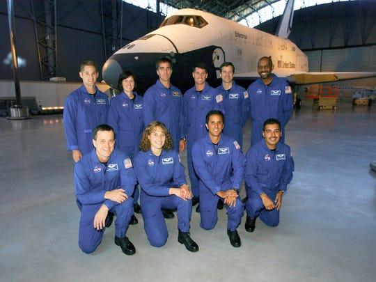 NASA's newest astronaut class poses in front of the Space Shuttle Enterprise at the National Air and Space Museum. Kneeling (from the left) are Richard R. (Ricky) Arnold II, Dorothy M. (Dottie) Metcalf-Lindenburger, Joseph M. (Joe) Acaba and Jose M. Hernandez. Standing, from the left, are James P. (Jim) Dutton Jr., Shannon Walker, Christopher J. (Chris) Cassidy, Robert S. (Shane) Kimbrough, Thomas H. (Tom) Marshburn and Robert L. (Bobby) Satcher Jr.