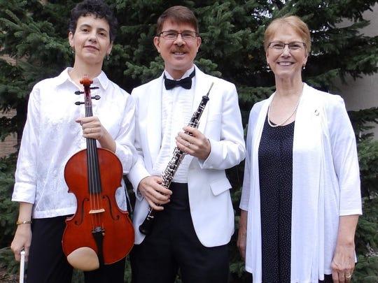 Ellen Olson, Eric Olson and Judith Jackson, from left,