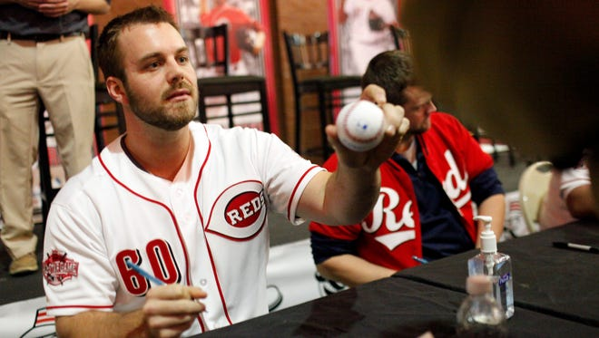 Cincinatti Reds pitcher J.J. Hoover autographs a baseball for fans during the annual Reds Caravan held at Slugger Field.  January  22, 2015