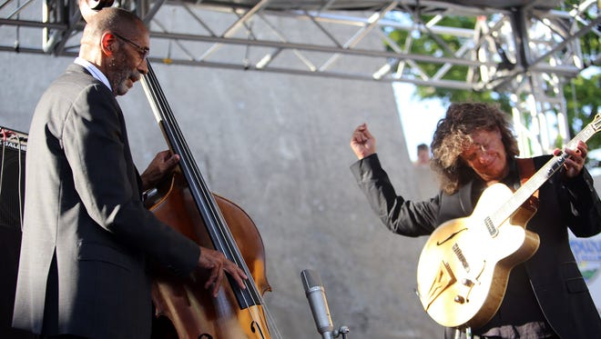 The  legendary Detroit-bred  bassist Ron Carter and  artist-in-residence Pat Metheny bring their first  song to a close during the top of their performance at the 36th Annual Detroit Jazz Festival on Sunday, Sept. 6, 2015 on the Wayne State University Pyramid Stage in Hart Plaza. The festival is the largest free-of-charge jazz fest in the world.