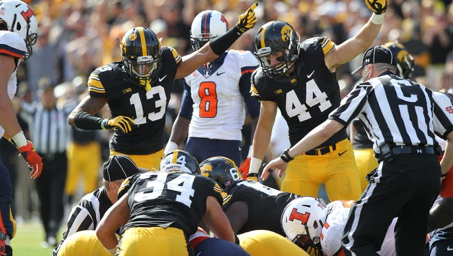 Iowa signals for a recovered fumble during their game against Illinois at Kinnick Stadium on Saturday, Oct. 10, 2015.
