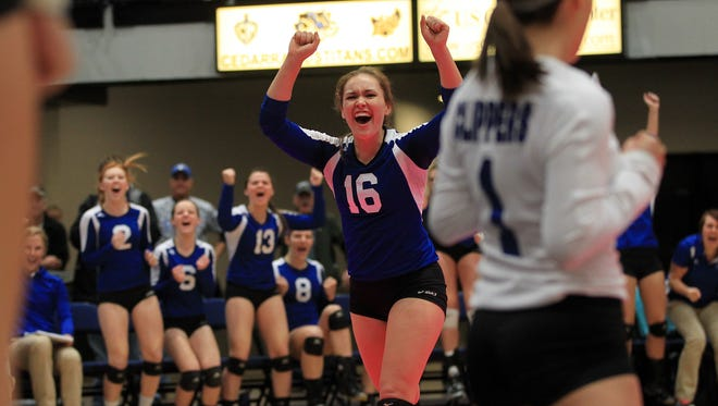 Clear Creek Amana's Alyssa Weldon celebrates a point during the Clippers' Class 4A semifinal game against Harlan at the U.S. Cellular Center in Cedar Rapids on Thursday, Nov. 13, 2014.  David Scrivner / Iowa City Press-Citizen