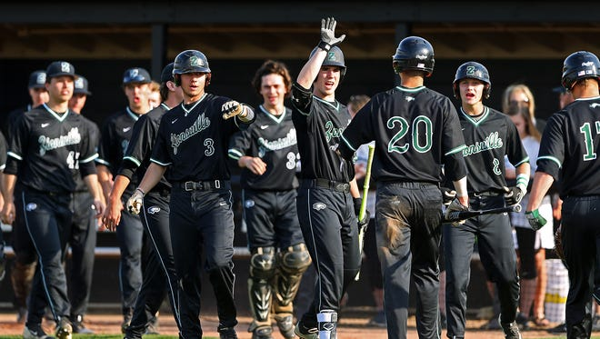 Zionsville Eagles' Jordan Cox (20) scores a run in the first inning as the team meets him to celebrate, at Field of Dreams diamond, Noblesville, Ind., Tuesday, April 19, 2016. Zionsville scored five runs in the first inning.