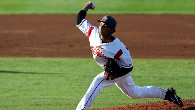 The Volcanoes' Victor Concepcion (15) pitches in the 20th anniversary season opener for Volcanoes baseball at Volcanoes Stadium in Keizer on Friday, June 17, 2016.