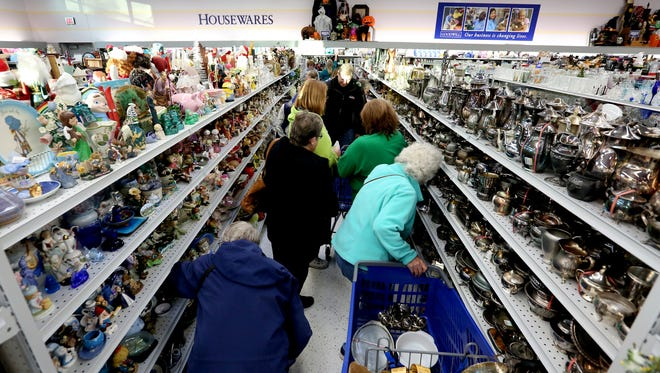 Shoppers search through housewares during the grand opening of the Goodwill store in West Salem on Thursday, Sept. 15, 2016.