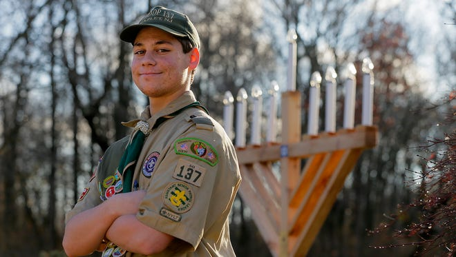 Eagle Scout candidate Max Rothman, 15, of Hazlet talks about  the 8-foot wooden Menorah he built for Hazlet Township to display during the holiday season outside of the James J. Cullen Center in Hazlet, NJ Wednesday December 7, 2016.