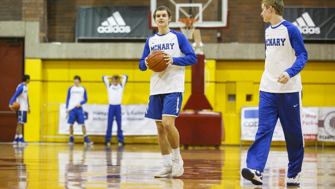 McNary senior Alex Martin walks to the basket for the second and final round of the 3-point shootout at the Capitol City Classic on Friday, Dec. 23, 2016, at Willamette University in Salem, Ore.