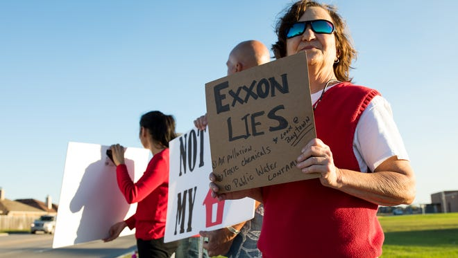 Portland resident Joan Morrison protests the proposed Exxon pant before Gregory-Portland Independent School District school board meeting on Tuesday, Feb. 21, 2017.
