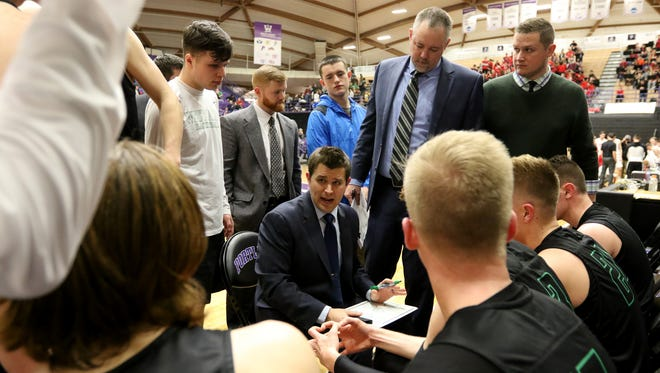 West Salem head coach Travis Myers talks with this team during a break in the second half of the West Salem vs. Clackamas boy's basketball game in the quarterfinals of the OSAA Class 6A State Championships at the University of Portland on Wednesday, March 8, 2017. Clackamas won the game 68-52. West Salem will play a consolation game on Thursday.