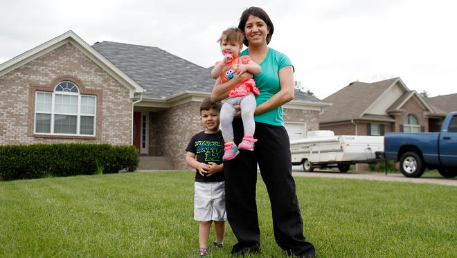 Amber Manion, right, with her daughter Declyn, 1, and son Lincoln, 3, in front of their new home in Mount Washington, Ky. Marion looked at approximately 100 homes over four months before buying her current home. May 1, 2017