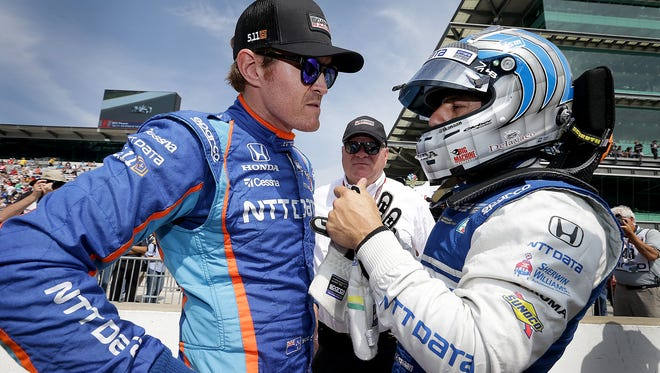 Chip Ganassi Racing IndyCar driver Scott Dixon (9),left, talks to teammate Tony Kanaan,right, during qualifying for the Indianapolis 500 Friday, May 20, 2017, afternoon at the Indianapolis Motor Speedway.