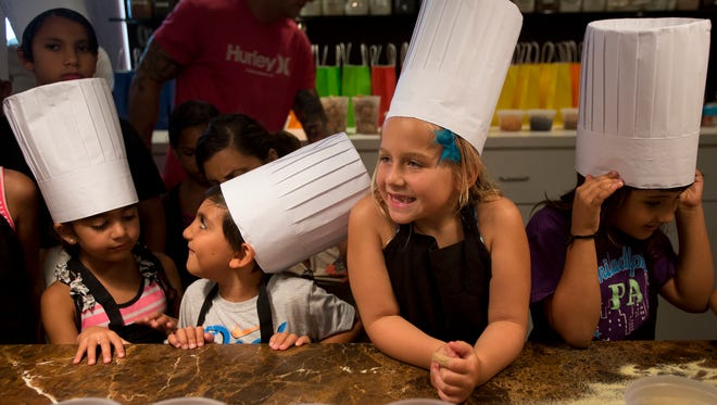 From left to right, Natalya Bendeck, Ricky Bendeck, Brooklyn Wright and Emilia Cardillo all prepare to make homemade pizzas during a kids cooking class at Sea Salt in Naples on June 25, 2016.
