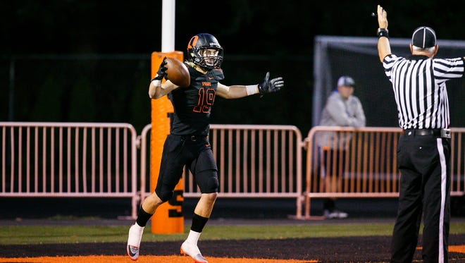 Sprague's Alek Altringer (19) celebrates after catching a long pass from quarterback Spencer Plant and taking off for a touchdown against McMinnville on Friday, Sept. 22, 2017, at Sprague High School. Sprague won the game 47-7.