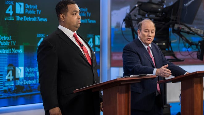 Mayoral candidates Coleman Young II, left, and Mike Duggan get ready for their debate at WDIV's studio in Detroit, Wednesday, October 25, 2017.