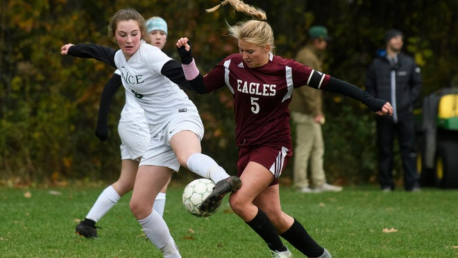 Rice's Fiona Connolly (6) and Mt. Abraham's Casey Ober (5) battle for the ball during the girls semi final soccer game between the Mt. Abraham Eagles and the Rice  Green Knights at Rice High School on Wednesday afternoon November 1, 2017 in Burlington.