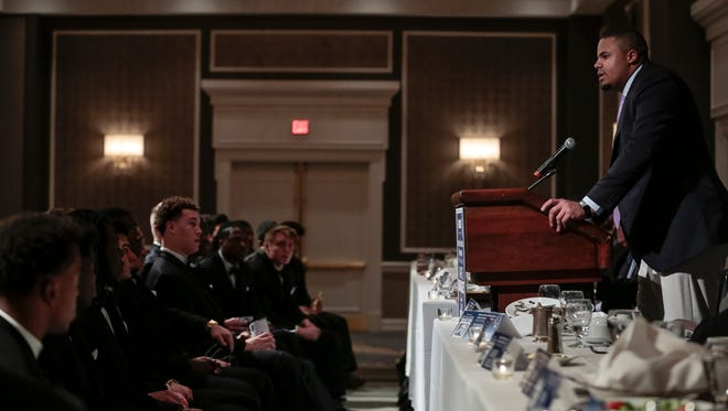 Michigan offensive lineman Grant Newsome speaks after receiving the Pete Schmidt Courage Award during the National Football Foundation State of Michigan Chapter awards banquet at the Dearborn Inn in Dearborn on Dec. 10, 2017.
