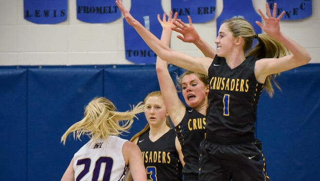 Melrose's Ashley Rademacher, 20, has no shot at the basket around Cathedral's Maya Van Erp, 3, Andrea Fromelt and Kate Tomczik during the fist half Thursday, Dec. 28, in the Crusaders Christmas Classic at Cathedral High School.