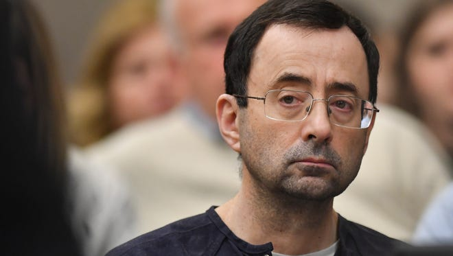 There was little reaction of the face of Larry Nassar as Ingham County Circuit Judge Rosemarie Aquilina delivered her sentence  Wednesday, Jan. 24, 2018, after the seventh day of victim impact statements in Ingham County Circuit Court.