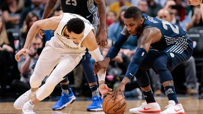 Nuggets guard Jamal Murray and Pistons guard Dwight Buycks battle for a loose ball in the fourth quarter Thursday in Denver.