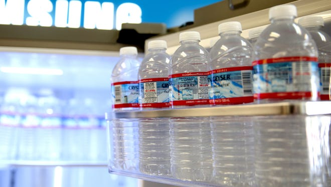 A refrigerator with bottled water is available at Willamette Valley Appliance in Keizer on Wednesday, May 30, 2018. The Keizer Chamber of Commerce asked willing businesses to open up their faucets for Salem residents in need of clean water.