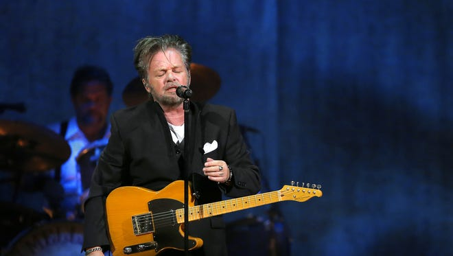 John Mellencamp sings his third song at Bankers Life Fieldhouse during his Plain Spoken Tour on Tuesday, August 4, 2015.