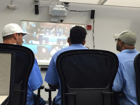 Inmates at San Quentin State Prison mentoring young people at the Ventura Youth Correctional Facility over Skype.