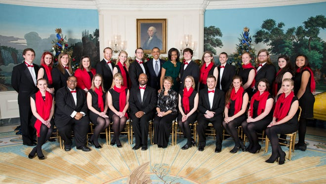 President Barack Obama and First Lady Michelle Obama greet the UNC-Asheville Chamber Singers in the Diplomatic Reception Room of the White House  Dec. 14, 2012. (Official White House Photo by Lawrence Jackson)This photograph is provided by THE WHITE HOUSE as a courtesy and may be printed by the subject(s) in the photograph for personal use only. The photograph may not be manipulated in any way and may not otherwise be reproduced, disseminated or broadcast, without the written permission of the White House Photo Office. This photograph may not be used in any commercial or political materials, advertisements, emails, products, promotions that in any way suggests approval or endorsement of the President, the First Family, or the White House.