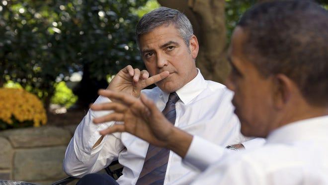 George Clooney talks with Barack Obama.