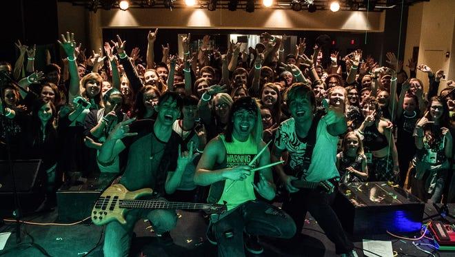 Jorge Dosdos, Alex Dosdos and Beau Zachowski of Green Screen Kid at their hometown EP release show in 2016.