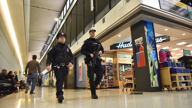 Police patrols inside the terminal B in Newark International Liberty Airport on Saturday, January 7.