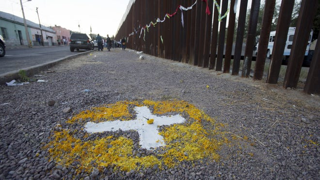 A cross marks the site near where Jose Antonio Elena-Rodriguez was shot to death by Border Patrol Agent Lonnie Swartz in 2012.