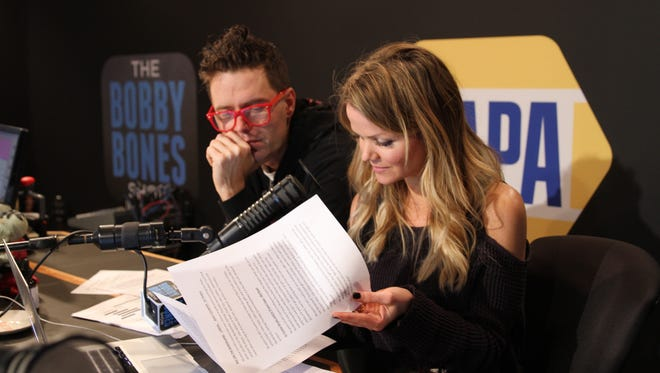 Bobby Bones and sidekick Amy Brown in the studio inside country radio station The Big 98 on Music Row