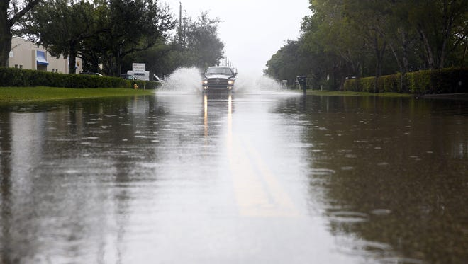 Flooding on Trade Center Way Sunday, Aug. 27, 2017, in Naples.