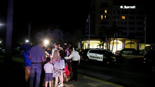 Family and friends gather outside of the Fort Lauderdale Marriott Coral Springs Hotel in Coral Springs, Fla. on Wednesday, February 14, 2018 after a shooting at Marjory Stoneman Douglas High School in Parkland, Fla.