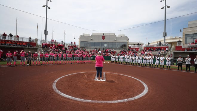 """Julie Goodin stands in the circle before delivering the first pitch for Indiana University's """"Think Pink"""" game this past Saturday in Bloomington. Her daughter Emily is a sophomore on the team."""