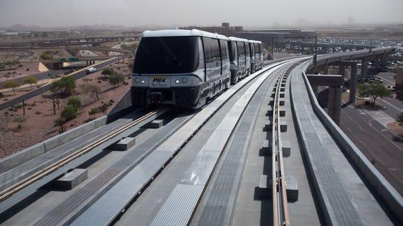 Nick Oza/The Republic PHX Sky Train transports passengers
