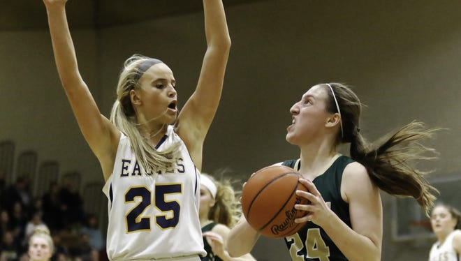 Hartland's Whitney Sollom (25) and Howell's Leah Weslock (24) made the All-Livingston County girls' basketball first team.
