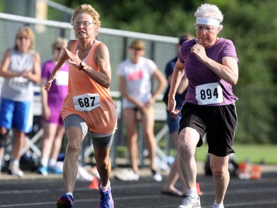 Lana Butler, left, and Patricia Caldwell compete in the 50-meter race during the Tennessee Senior Olympics held at Battle Ground Academy Sunday, June 21, 2015.