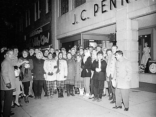 Tiny Tim Christmas carolers sing in front of the J.C. Penney store at 727 Landis Ave. A part of Vineland's downtown for 50 years, J.C. Penney was located on Landis Avenue from 1927 until 1977, when the store moved to the Cumberland Mall.